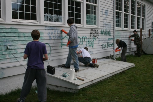 Scouts remove graffiti from Nichols Center